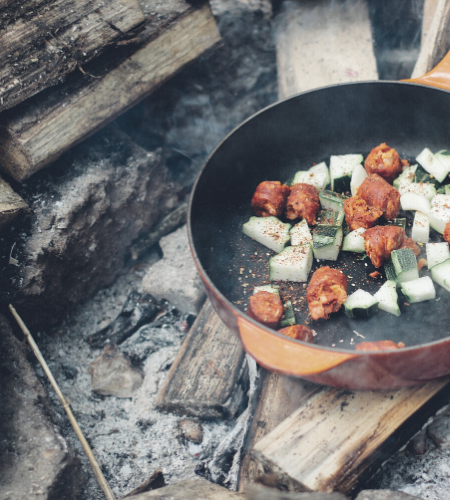 cooking campfood on an outdoor fire