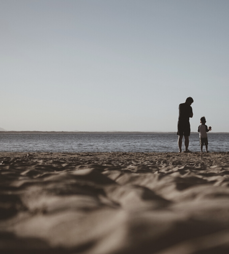 dad and son by the beach