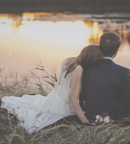 young couple just married by the lake
