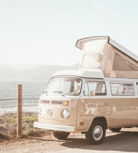 caravan on the dirt road by beach